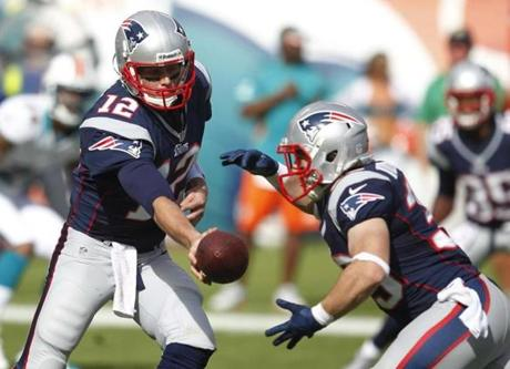 Brady handed the ball to running back Danny Woodhead during the first half.